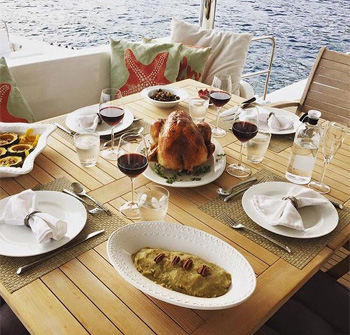 Dinner aboard a crewed yacht charter